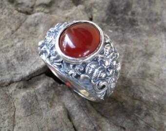 Silver ring rangda motif with carnelian stone
