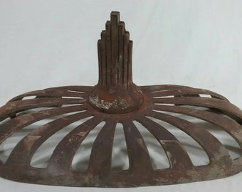 Antique cast iron stove top art deco with finial