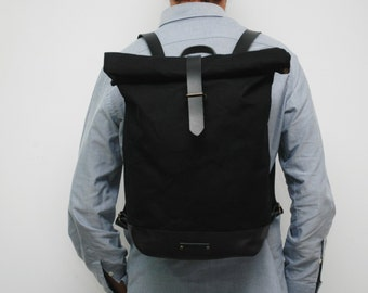Waxed Canvas rucksack/backpack,black color,with handles, black leather bottom, and closures