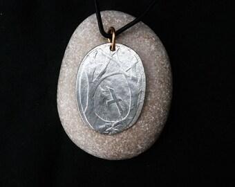 Raven through trees, pendant or brooch