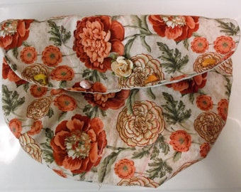 """Floral clutch, size 12"""" x 8"""". Vibrant colors, tiny silk flower on flap. Two inside pockets, cream patterened lining. Roomy!"""