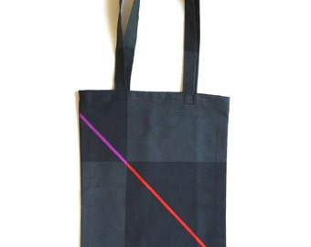 Black and  grey geometric small tote bag with a red/purple stripe, foldable, reusable, fabric bag