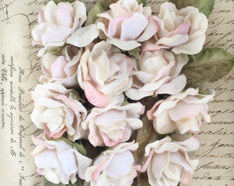 velvet roses 12 pack. craft roses. buttonhole roses. wedding favours. parcel toppers. millinery roses. doll and teddy bear roses.