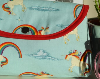 Handmade unicorn makeup bag with attached brush roll.