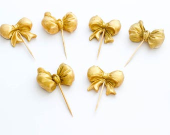 12 x 3D metallic sugar fondant bow cake toppers / cake stakes gold or silver