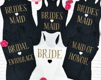 9 Bridesmaid Shirts. 9 Bridesmaid tank tops. 9 Brides Entourage Shirts. 9 Wedding Tank tops. 9 Wedding Shirts. Wifey tank top.