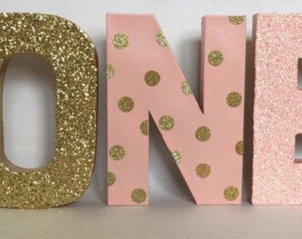 pink and gold glitter stand up one letter sign first birthday photo prop party decor paper mache letters winter onederland decoration
