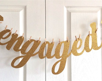 ENGAGED Banner. Cursive. Gold glitter.Engagement party decoration, photo shoot.We're engaged, bride to be, she said yes.Diamond ring.Custom.