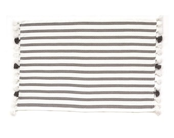 Matching Bath mat and hand towel. Hand made with pom-pom fringes.100% Turkish Cotton.