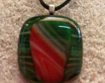 Medium green glass pendant with red and white highlights