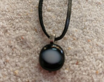Small black glass pedant witha white highlight