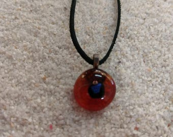 Small brown clear glass pendant with blue shimmer