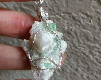 Natural, rough quartz with green tourmaline wire wrapped pendant 53.2cts