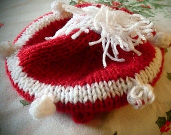 Baby Christmas Hat in red and white two different designs tamoshanta and a snuggle hat with rose lovely and warm xmas presents