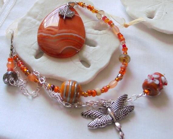 Orange gem sun catcher- window focal point - agate teardrop - dragonfly charm - canada maple leaf- unique house warming gift- Lizporiginals
