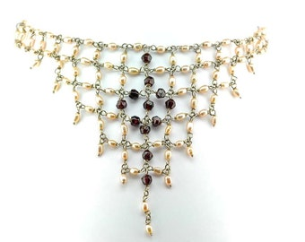 Fresh water pearls and garnet Necklace with sterling silver wire.