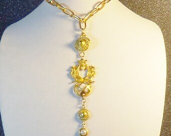 Historical looking pendant on a muted gold chain