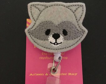 Raccoon ID badge reel holder retractable clip