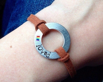 """LGBTQ """"Loved"""" Bracelet, Hand Stamped with a Rainbow hand painted on Metal with Leather. Adjustable length silver clasp"""