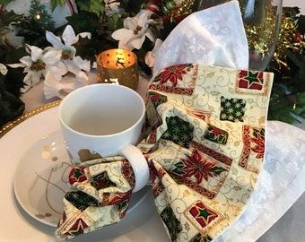 Elegant and cheerful large dinner napkins featuring Christmas motifs of poinsettias, stars, and holly, set of 4, reversible.