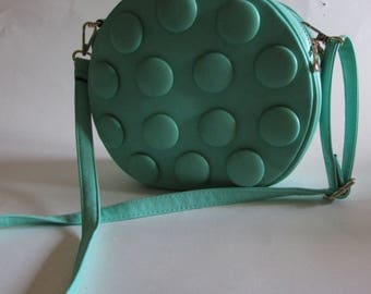 Vegan retro turquoise round hand bag studded with dots, handle and strap for easy access/new with tags