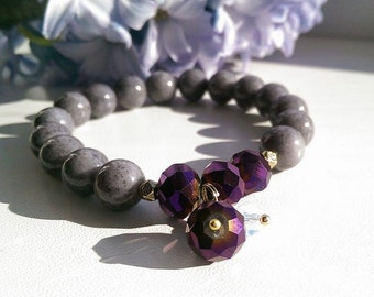 Natural gemstone beaded gray jade bracelet with purple holographic charm.