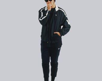90's Vibe black and white Champion mens windbreaker jacket