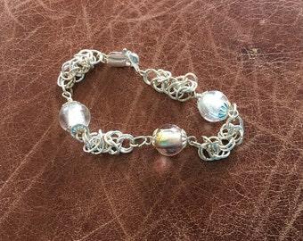 Glass foil and silver plated Byzantine weave bracelet