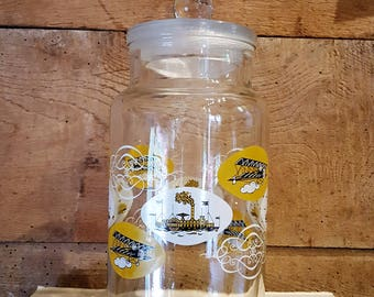 Vintage Glass Storage Jar with Transport Motif