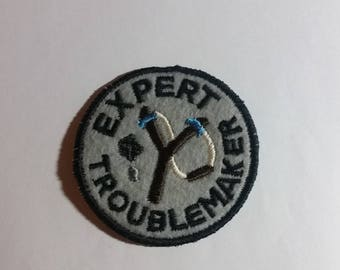 Expert Troublemaker Grey Black Embroidered Merit Badge