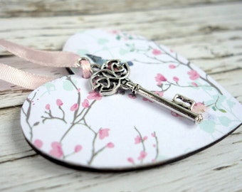 Key to my Heart romantic Valentine gift. White hanging wood ornament with bird & blossom design and silver metal key. In gift bag