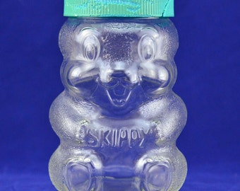 Skippy Peanut Butter Beaver Clear Glass Jar - Special Edition Advertising Coin Bank - 100th Birthday Commemorative Jar with Plastic Lid