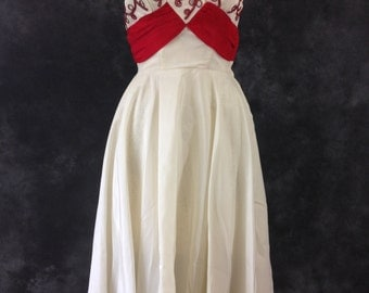 Vintage 1950's white and red rayon taffeta strapless dress. Red soutache and rhinestones.