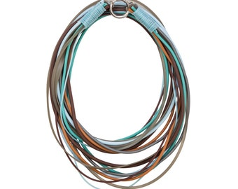 multi strand necklace, soft blues, teal, tan, browns, edgy fashion, unique jewelry,
