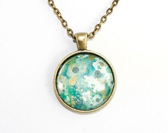 Splatter Painting Pendant - Abstract Art - Round Brass Necklace - Caribbean Waters Colorway: Aqua, gold, teal