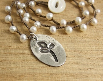 Crocheted Necklace with Brown Cord, Pearls and an Oval Pedant with a Leaf Design SN-214