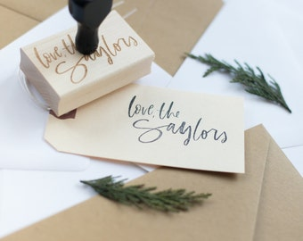 "custom brush lettering ""Love, the Saylors"" stamp"
