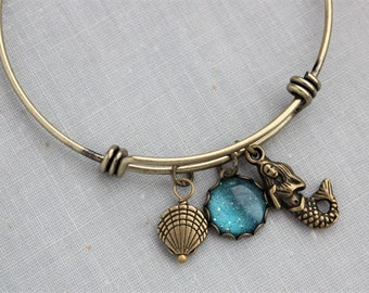 Mermaid Bangle Charm Bracelet in Antique Brass. Teal