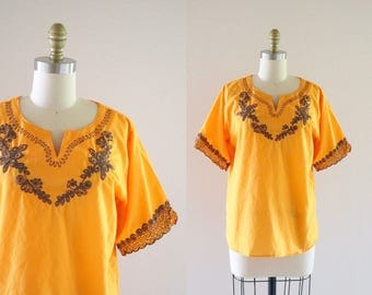 1970's embroidered cantaloupe blouse