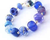 Handmade lampwork glass bead set of 12 blue, cobalt and navy orphan beads - blue renegades