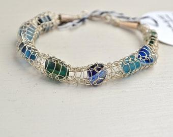 Genuine Bracelet Multi blues , green Sea Glass and Fine Silver Wire Knit