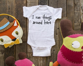 I run things around here - funny saying printed on Infant Baby One-piece, Infant Tee, Toddler T-Shirts