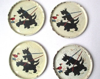 Vintage Scottie Dog Tin Coaster Set, featuring two black dogs playing with a Duck pull toy