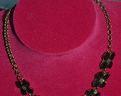 Striking vintage floral choker necklace in black and gold.