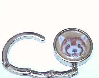 Red Panda Folding Handbag hook, to hang your purse under a table. Foldable, pocket-sized bag holder, with a happy Red Panda design