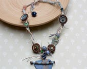 Mixed media necklace in blue green and brown Tribal statement jewelry, Fiber art necklace with twig, clay, leather and wooden beads, OOAK