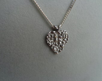 Silver .925 heart pendant with silver chain.