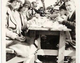 Old Photo Women and Men having Picnic wearing Coats Hats Picnic Bench 1920s Photograph Snapshot vintage