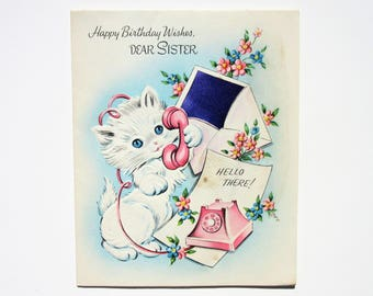 Vintage Unused Embossed Happy Birthday Greeting Card to a Dear Sister Featuring a White Cat Using a Retro Pink Telephone Birthday Greetings