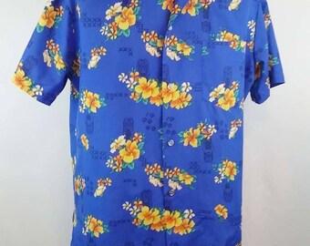 1980's Men's Blue Hawaiian Tiki God - Flowers -Shirt Vintage Men's size X-L Vacation - Party - Beach in excellent vintage condition.